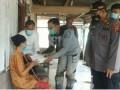 Kapolres Tebingtinggi Minta Masyarakat Desa Marjanji Patuhi Prokes COVID-19 dan Serahkan Bantuan